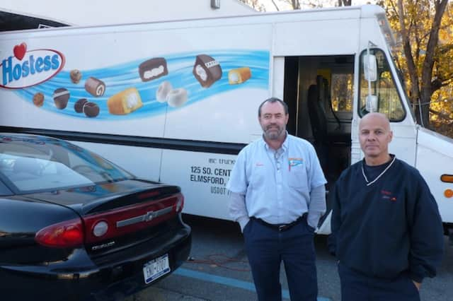Delivery drivers Lou Maresco, left, and Chris Shiaffarelli stand in front of a Hostess Brands truck at the company's Elmsford bakery outlet. Hostess Brands announced Friday that it is going out of business.