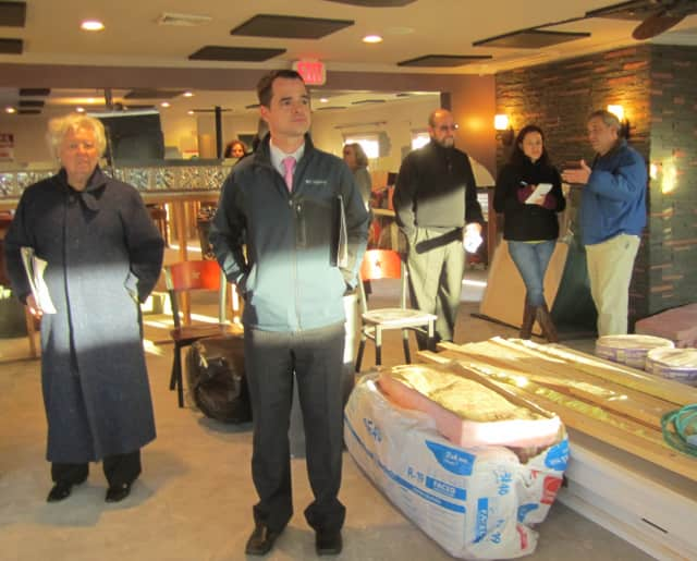 Assembly member Sandy Galef (D-Ossining) and state Sen. David Carlucci (D-Rockland/Orange) survey damage Friday at Ossining's Boat House Restaurant.