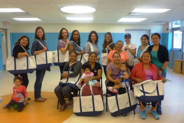Community messengers trained by the Promise for Children Partnership in Danbury offer information to families at the Head Start Building in Danbury.
