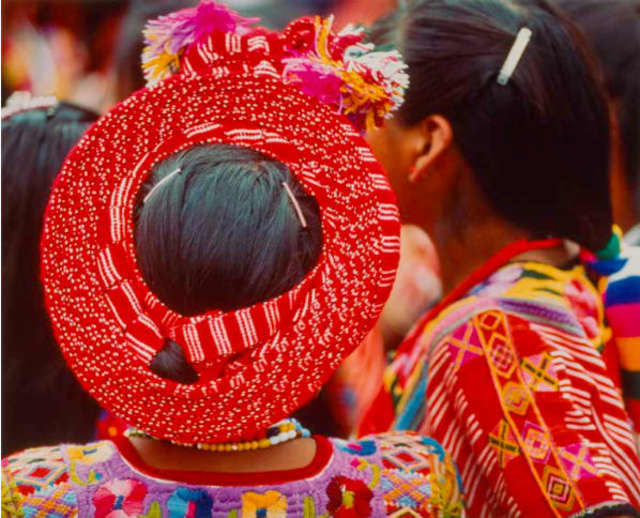 Guatemala, back of young girl's head, red head wrap