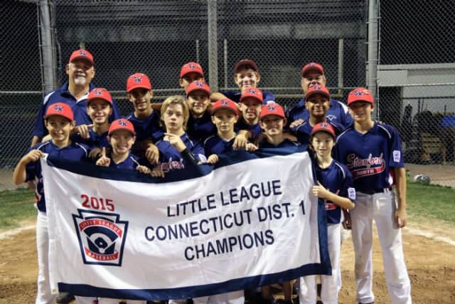 Stamford North Little League players and coaches celebrate after beating Weston for the District 1 title.