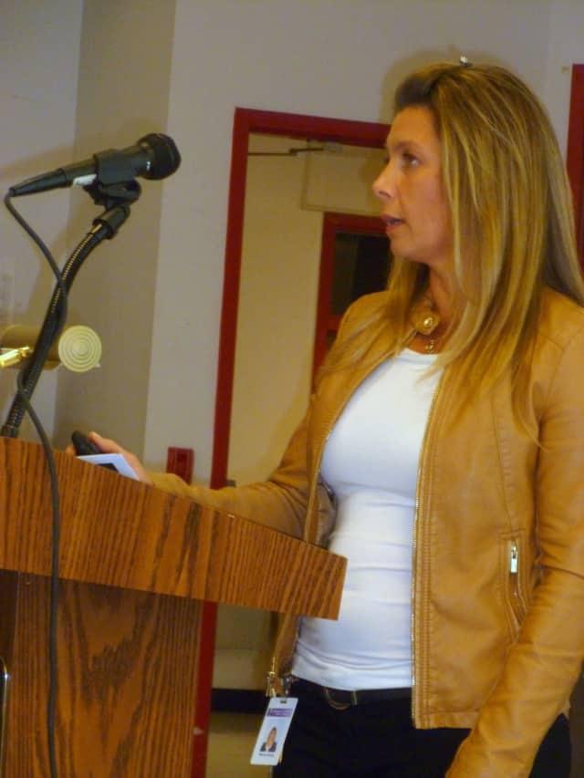 Social worker Wendy Bucaj explains the peer mediation program to the Katonah-Lewisboro School Board.