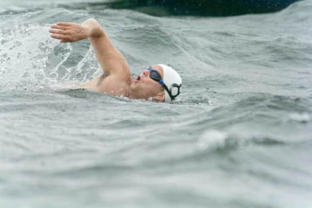 A swimmer powers through the water at last year's Swim Across The Sound event in Long Island Sound, which benefits St. Anthony Medical Center in Bridgeport.