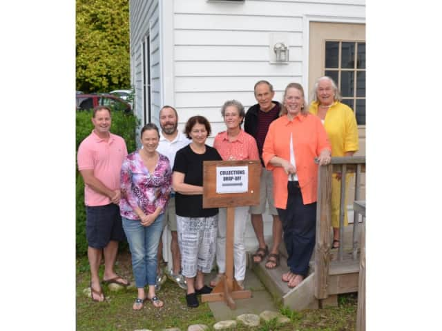 Emmanuel Church Family Fair volunteers from left: Boyd Relac, Priest in Charge Katy Herron Piazza, Charlie Shipman, Betsy Ready, Chris Juneau, Dan Wilder, Ellen Uzenoff and Donna Wilder.