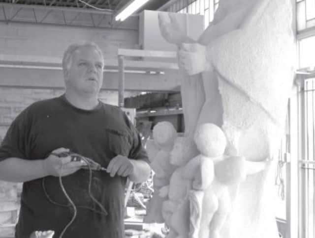 Owner, Jim Bria with unfinished sculpture the Assumption at Artista Studios and Monument Works in Bridgeport.