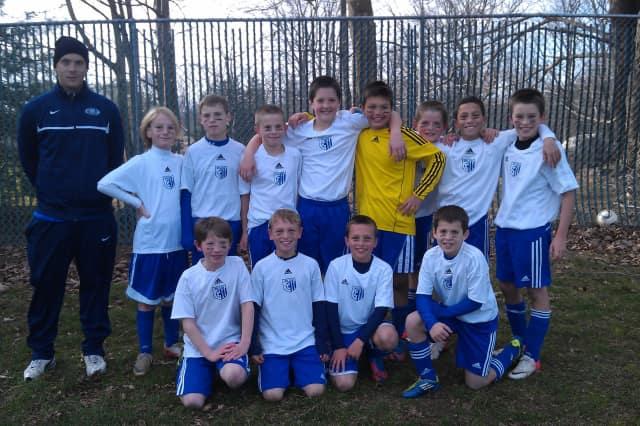The Wilton Blue under-11 boys soccer team won the league championship.