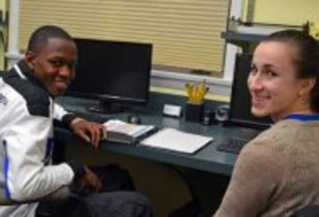 Becca Rakowitz, right, tutors Jerome Atkinson in chemistry in 2013 as part of the Beyond Limits Academic Program.