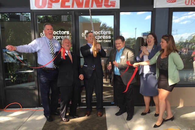 Staff from AFC/Doctors Express Urgent Care Center, as well as Norwalk Mayor Harry Rilling and Chamber of Commerce President Ed Musante cut the ribbon on the new location in Norwalk.