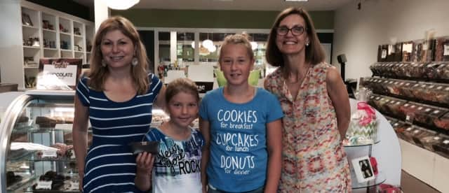 Meredith Scheine, owner of Chocolate Works, Stefanie Frank, Alexandra Frank and Susan Cator, president of the Darien Chamber of Commerce.