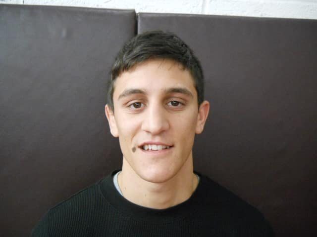 Former three-time Section 1 wrestling champion Mark Arcara has returned to Harrison as the varsity assistant wrestling coach.