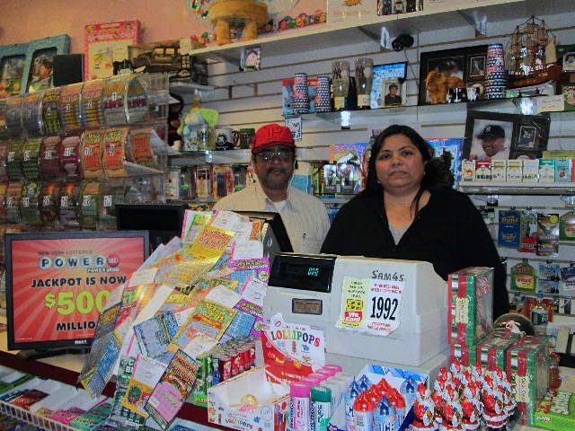 Nisha Kenia, right, owner of Candyland in Bronxville, said Bronxville residents have been buying Powerball tickets even in the snow.
