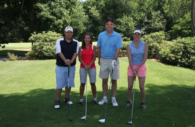 From left, Mike Testa, Janine DiCarlo, Dan Donovan, Lauren Ryan at the golf outing, which has raised more than $6 million for charity in its 28-year history.