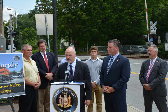 Several elected officials gathered to support cameras at railroad grade crossings.