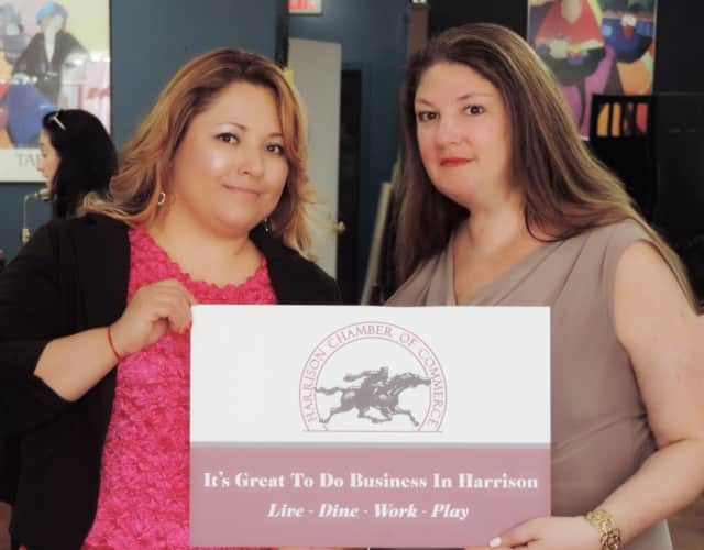 Chamber President Holly Sharpe, right, with Brenda Maeda, the organization's vice president, recently promote the community's business district.