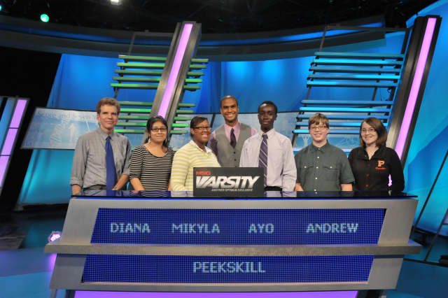 """The Peekskill students competing on """"The Challenge,"""" are Diana Barreto, Mikyla Abdul-Azim (captain), Ayomide Jegeded, Andrew Wise and Toluwanimi Jegede. At left is academic adviser Greg Erickson and in center is """"The Challenge"""" host Jared Cotter."""