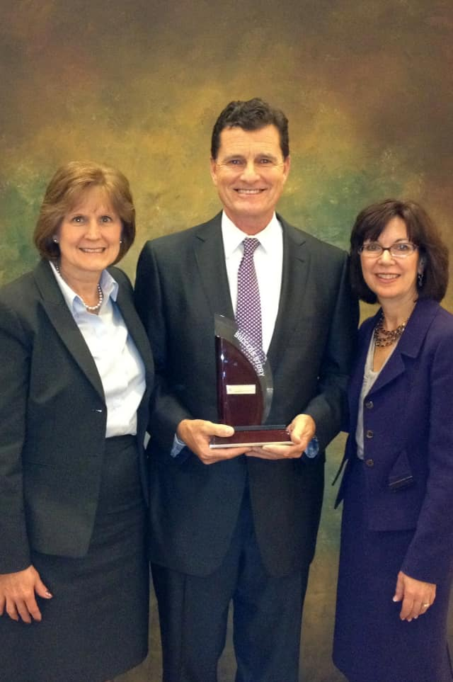 "Vice President of Human Resources Jeane Costella (left) and Vice President of Administration Debbie Neuendorf (right) accept Press Ganey ""Success Story Award"" from Press Ganey CEO Patrick Ryan."
