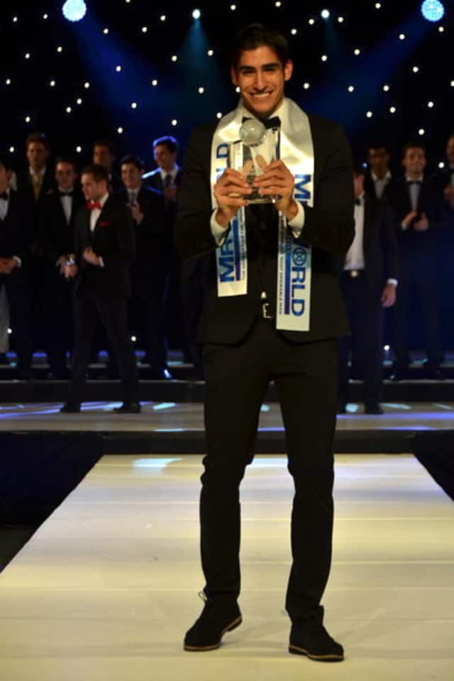 """Monroe College pole vaulter Francisco Escobar won the two-week """"Mr. World"""" competition in the United Kingdom."""