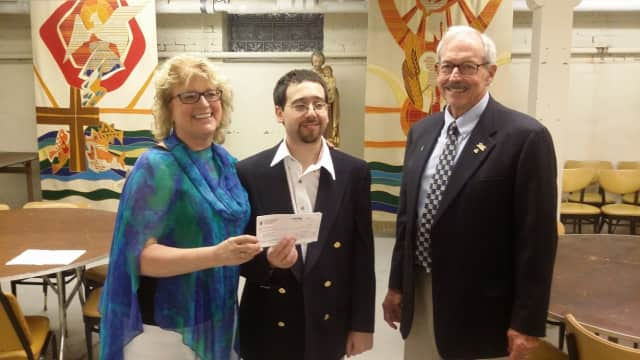 Katie Banzhaf, executive director of STAR with Norwalk resident Nick Ippolito and Steven Haywood of the Knights of Columbus 1253.