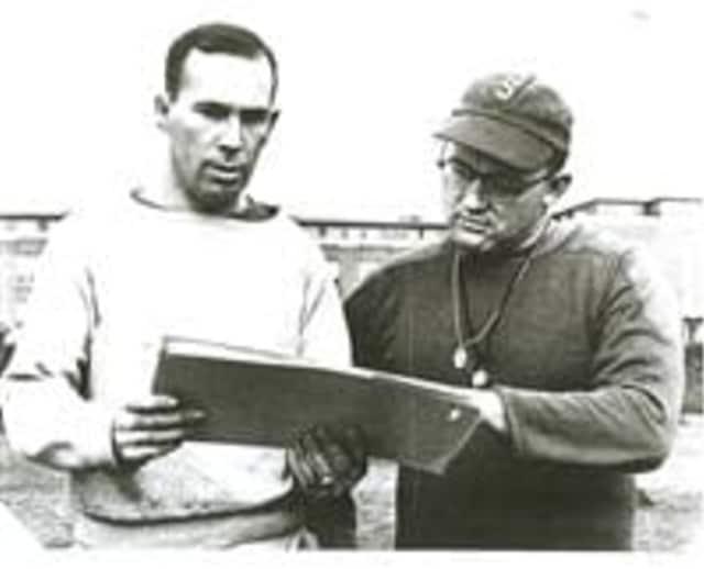 Then assistant coach Joe Sullivan, left, conferring with Stepinac coach Buzz Werder in 1957.