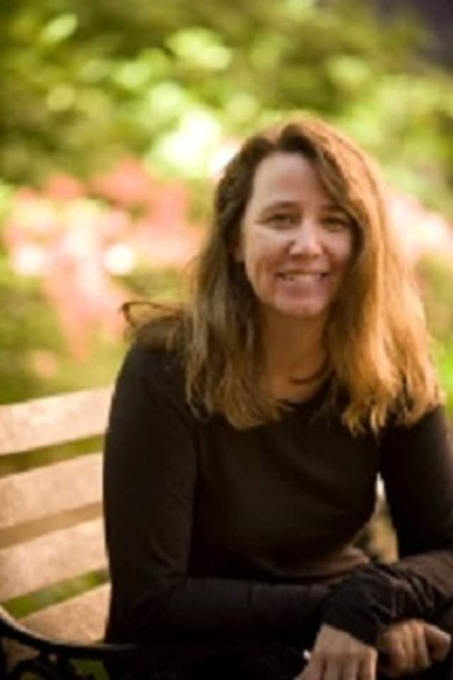 """Poet Carol Ann Davis will read from her latest collection """"Atlas Hour"""" Sunday at the Katonah Village Library."""