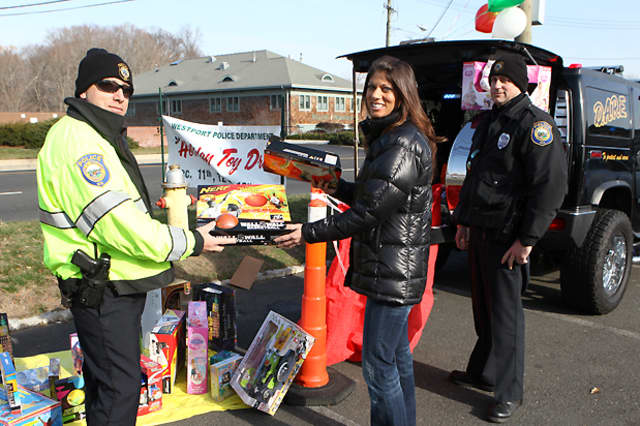 Westport police collect donated toys during a past year's holiday toy drive. This year's toy drive will be held Dec. 9, 10, 16 and 17 outside the Athletic Shoe Factory, 1560 Post Road E.