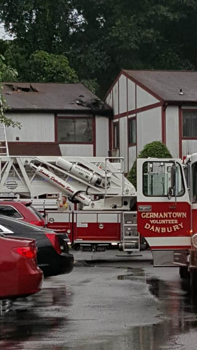 The damage from the lightning strike can be seen on the roof of this condo building at at 51 Candlelight Drive in Danbury.