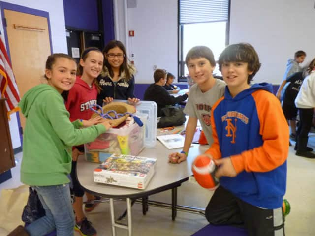 Sixth-graders at John Jay Middle School prepare packages for victims of Hurricane Sandy.