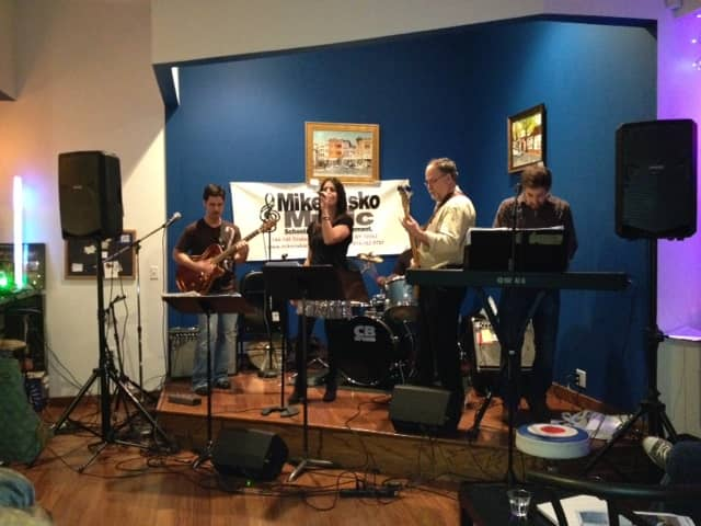 Mike and Miriam Risko, at left, play at their Ossining studio for a benefit concert for victims of Hurricane Sandy.
