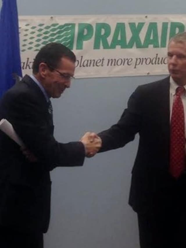 Gov. Dannel Malloy and Chairman and Praxair CEO Steve Angel in Danbury last fall