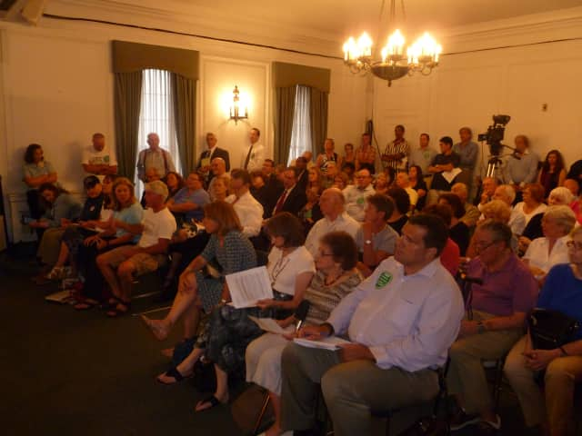 White Plains residents at one of many crowded hearings at Common Council chambers during the four years the French-American School of New York proposed building a new campus at the Ridgeway Country Club. FASNY lost by one vote on Wednesday.