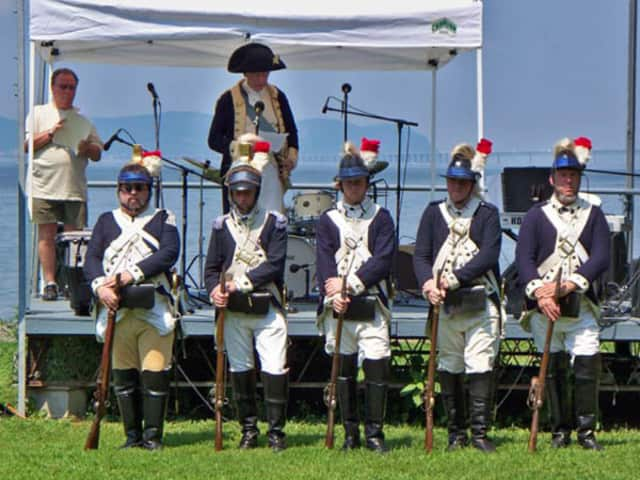 Re-enactors of the Second Continental Light Dragoons march in an earlier Dobbs Ferry Freedom Walk.
