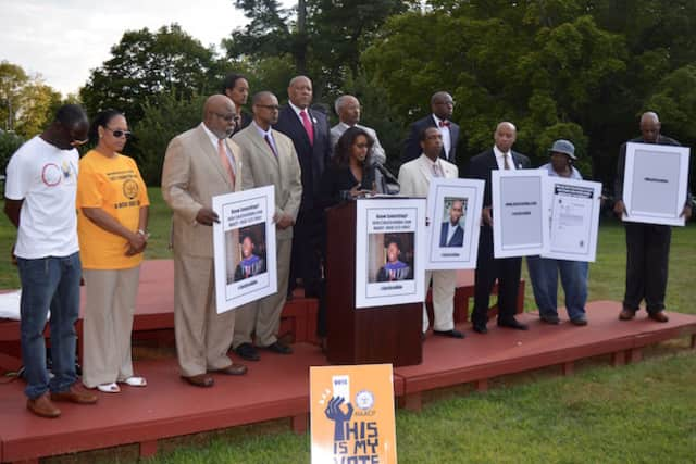 Abe Dabela's sister, surrounding by NAACP members from across the state, discusses the investigation into the Redding man's death.