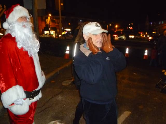 Ardsley Mayor Peter Porcino, right, joins Santa in counting down to the Christmas tree lighting.