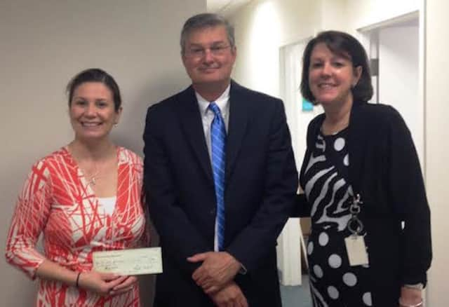 The Center's Executive Director Ivonne Zucco receives the grant with First County Bank Foundation's Rosemary Odgen and David Metzger.