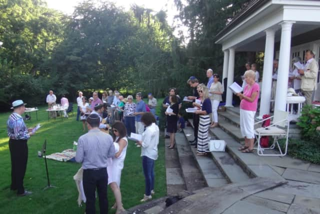 Rabbi Mitchell M. Hurvitz and Cantor Asa Fradkin of Temple Sholom led the synagogue's annual beach service on Friday, August 7, 2015 at a private home overlooking Cos Cob Harbor.