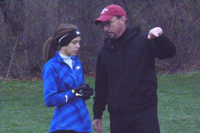 Stamford's Megan Rule talks with coach Kevin Foley of the Connecticut Elite at a practice in Wilton last week.