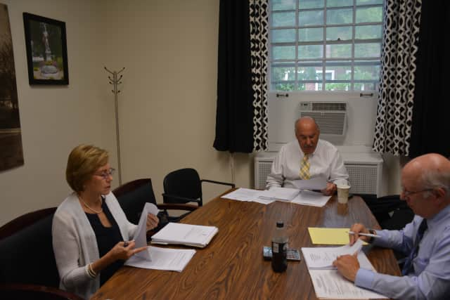 Mayor Michael Cindrich (center) and Trustee Jean Farber (left) meet at a work session. The board lacked a quorum, which meant that a regular meeting could not be held.