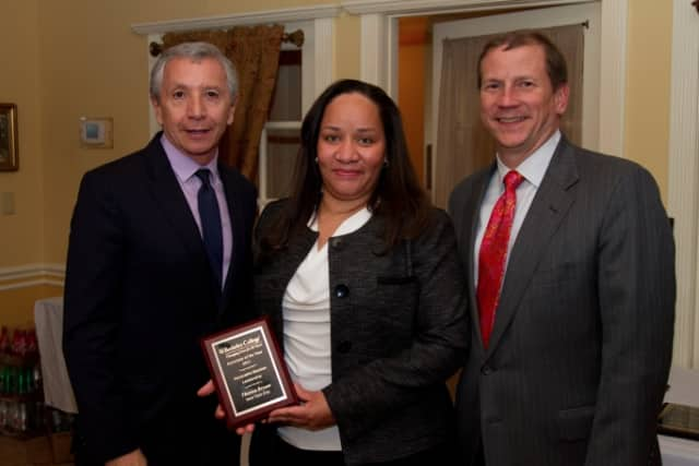 Berkeley College President Dario A. Cortes with Port Chester resident Theresa Bryant and Kevin L. Luing, chairman of the board of Berkeley College.