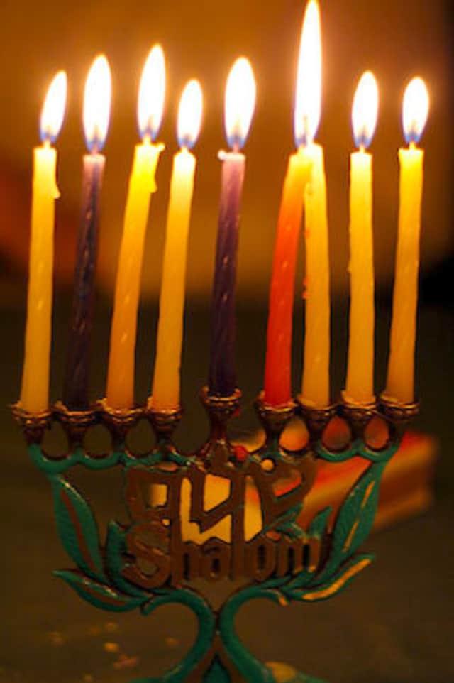 The Mishkan Israel Day Camp will conduct a Hanukkah menorah lighting on the Monroe Town Green Dec. 7.