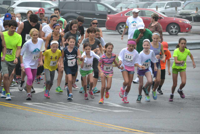 Children and families take off from the starting line at the 2014 Kisco 5K Road Race.