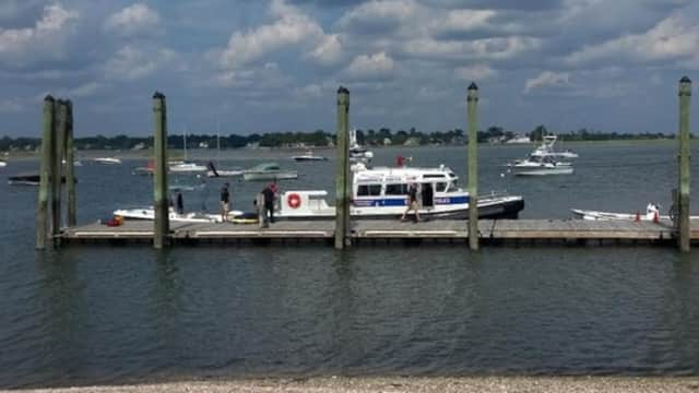 A Stamford woman was rescued after falling overboard off Greenwich on Sunday afternoon.