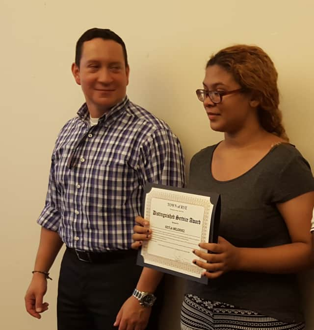 Keyla Menendez receives her award for completing the town of Rye internship program from Alex Payan, a consultant with the town. Menendez interned with Carol Nielsen at the Port Chester Senior Community Center.