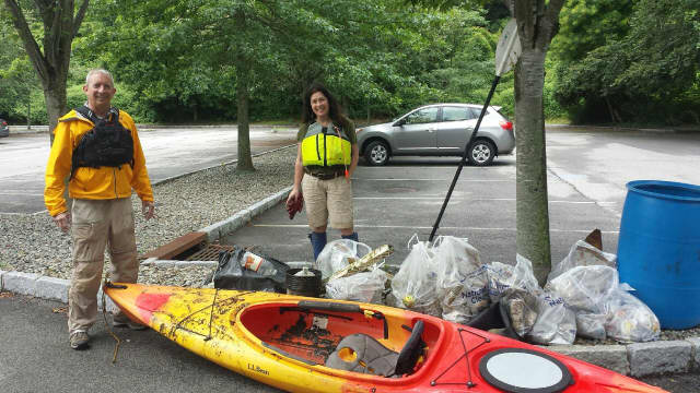 L.L. Bean volunteers Angel Tinnirello, of Rye, and Carl Steiniger, of Manhattan, complete cleanup work at V.E. Macy Park in Greenburgh.