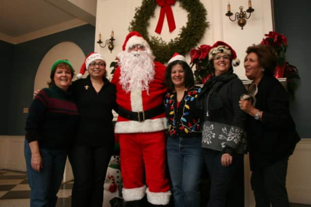 Santa Claus with members of the then Eastchester-Tuckahoe Chamber of Commerce in 2012. He has made annual trips to town since 2008.
