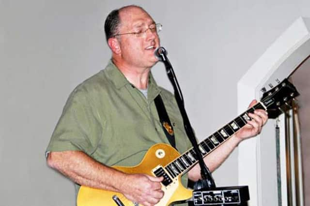 North Salem resident Eric Pooley performs with his band, Goat Rodeo, at The General Store on Friday.