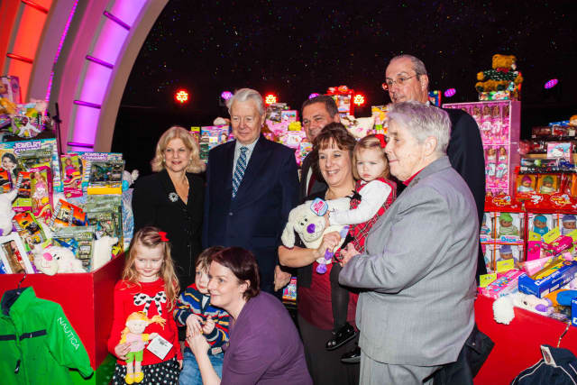 Empire City Casino current CEO Timothy Rooney (center) joined city and county officials in presenting hundreds of donated toys to Catholic Charities inside Empire City Casino, which now may be sold to MGM Resorts.
