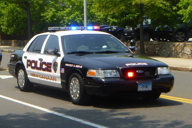 New Canaan Police responded when a car crashed into a tree Wednesday night.