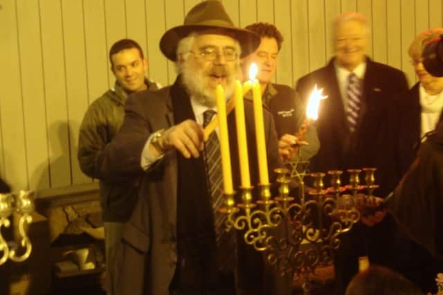 Rabbi Yehoshua Hecht of Beth Israel of Westport and Norwalk lights the Menorah at a previous Stew Leonard's Community Menorah Lighting Celebration.