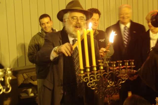 Rabbi Yehoshua Hecht of Beth Israel of Westport and Norwalk lights the Menorah at a previous Stew Leonard's Community Menorah Lighting Celebration.