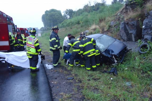 A car rolled over and hit a rock wall on I-95 north in Norwalk Friday morning.
